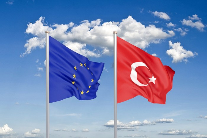 European Union vs Turkey. Thick colored silky flags of European Union and Turkey. 3D illustration on sky background. - Illustration