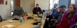 Picture of team meeting at table