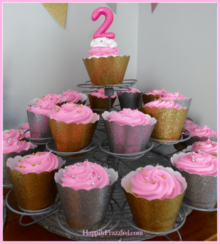 Add glitter to your party decor by using scrap-book paper to make custom cupcake wrappers | HappilyFrazzled.com