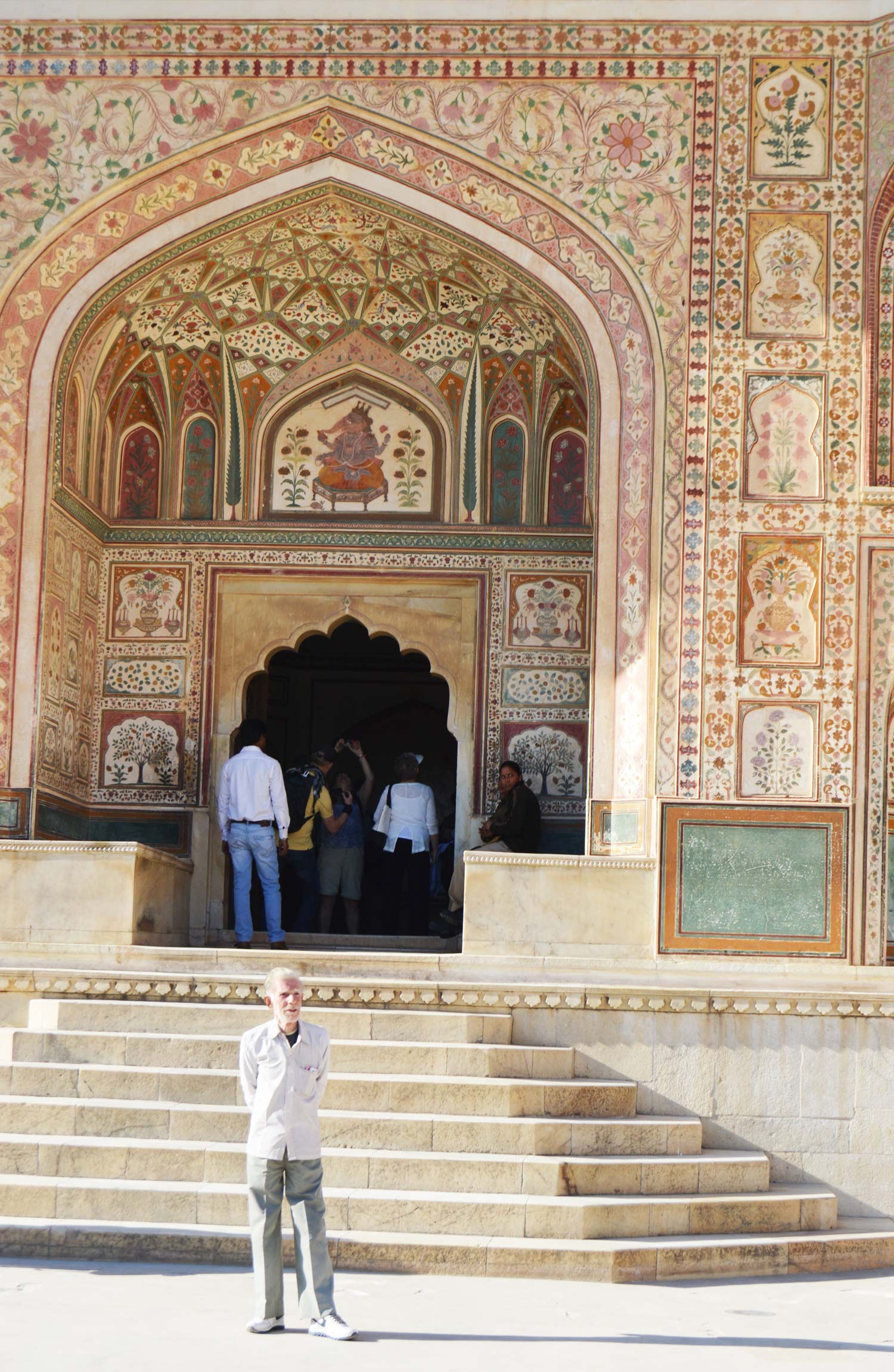 Our guide, standing in front of one of the many intricate buildings within the fort. The paint is all original.