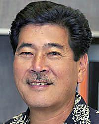 Head shot of Gene Awakuni