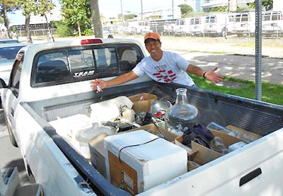 David Wong loads his truck