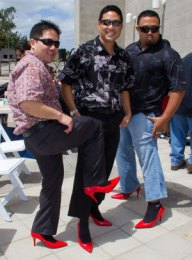 3 men in red heels