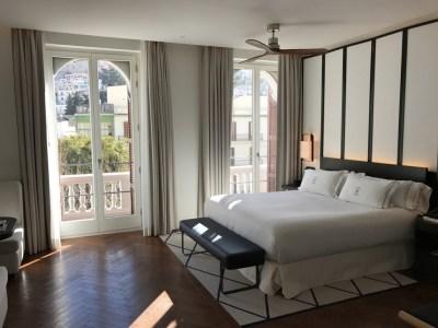 Gran Hotel Montesol Curio Hilton Ibiza bed open curtains