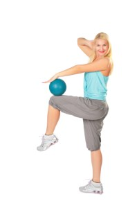 Woman practises with a blue ball