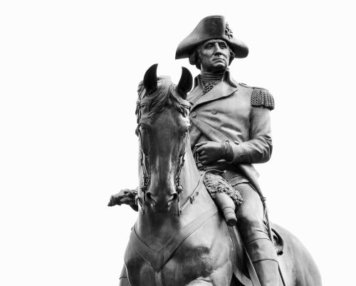 This statue of George Washington stands regally in the Public Garden in Boston, Massachusetts. It is located at the Arlington Street gate which faces Commonwealth Avenue, and was sculpted by Thomas Ball in 1869.