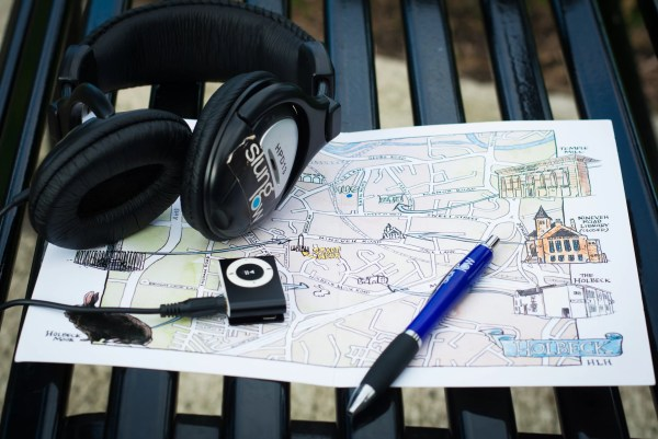A Map of Holbeck, a Pen and an MP3 Player with Headphones on a Bench