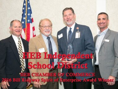 Steve Chapman accepts the Bill Ridgway Award from last year's winners, the Economic Development Directors of Hurst, Euless and Bedford