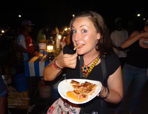 Eating a Zanzibar Pizza at Forodhani Gardens in Stone Town, Zanzibar.