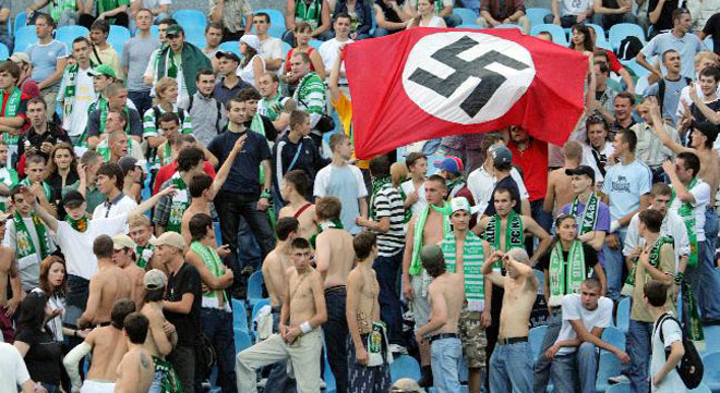 Fans at soccer games fly a Nazi flag and are not accidental racists.