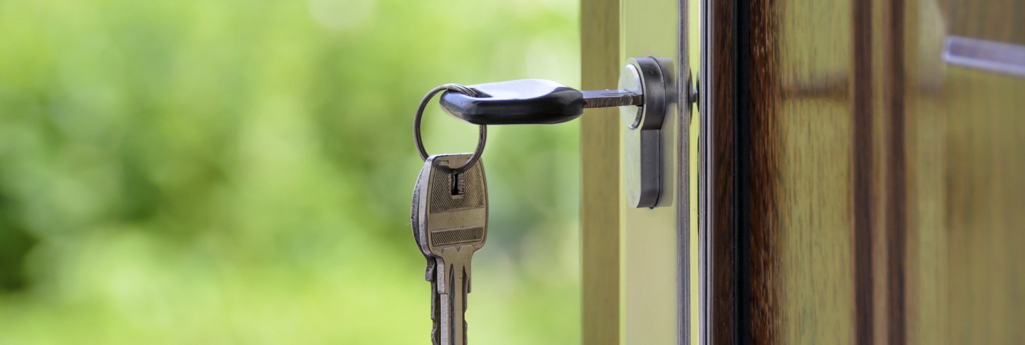 Keys and lock the door on the background of solar garden