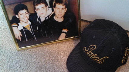Mike Russo (left), two of his best friends, Eric and Lance, and his favorite hat. You are greatly missed, Mike.