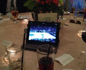Half of the setup at Table 11. The other iPad is hidden and propped behind the centerpiece.