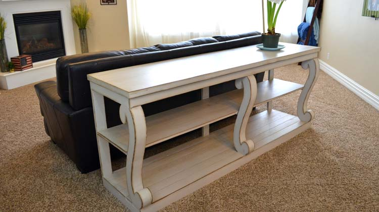 console table with curvy legs feature