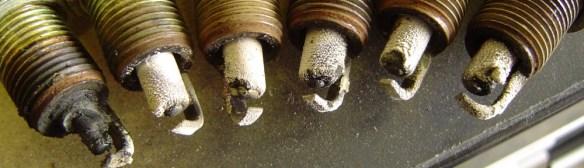 Worn spark plugs, causing engine code P0300
