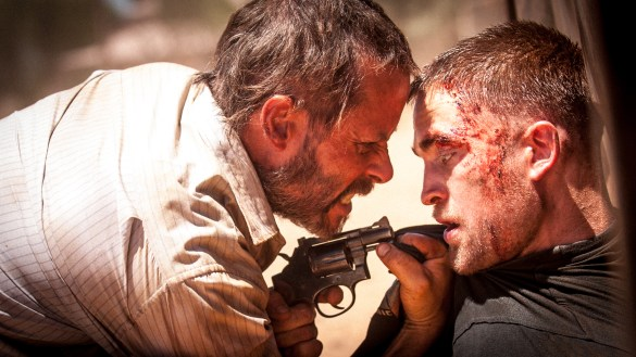 Guy Pearce and Robert Pattinson in The Rover 585x329 First Look Image: Robert Pattinson and Guy Pearce in The Rover