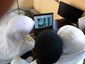 Students working on the Nigerian FLag