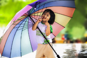 kid with large umbrella