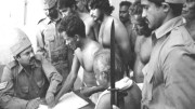 A still from documentary film Regai, in which Piramalai Kallar community members are forced to affix their thumb impression under the Criminal Tribes Act. Source: www.chennaifirst.in