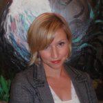 Krista Creel in front of artwork