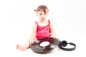 baby and vinyl record.