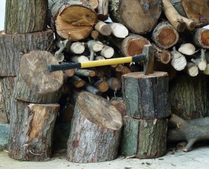 pile of wood with axe in one of the pieces