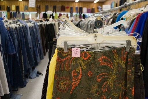 inside a thrift store racks of clothes