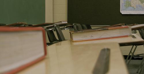 empty classroom close up of desks and books