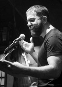 jonathan mack reading at mic