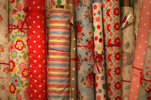 different, retro patterns of fabric rolls