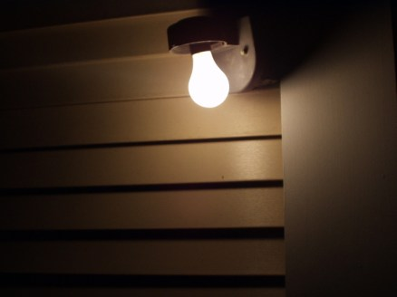 porch light bulb on, otherwise dark