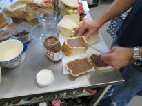 Spreading Nutella for the hip Bread & Butter pudding
