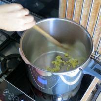 Saute garlic, ginger and hot pepper in sesame oil.