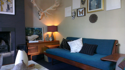 Teal upholstered studio couch in Heather Linnitt's sitting room