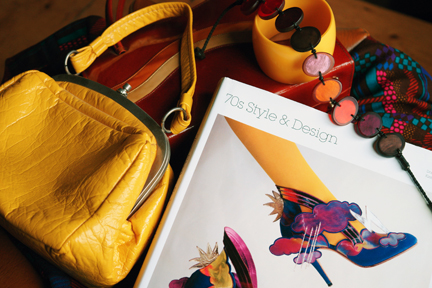 "cover from the book, ""70s Style & Design"" styled with vintage 1970s ladies handbags, dress & jewellery"