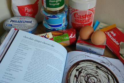 &quot;Cheesecake&quot; book by Hannah Miles with ingredients to make a chocolate &amp; ginger cheesecake