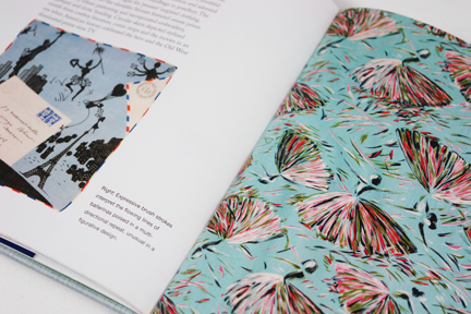 "page from the book entitled ""1950s Fashion Prints"" by Marnie Fogg showing vintage 1950s fabric with ballerina print"