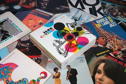 """Jazz Covers"" book surrounded by vintage jazz LPs"