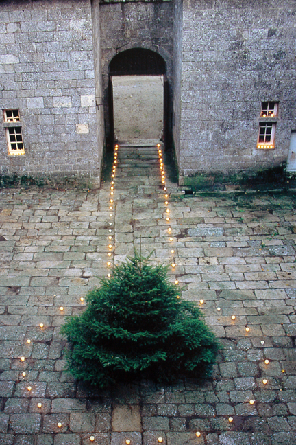 "page showing candlelit courtyard from ""The Way We Live In the Country"" by Stafford Cliff & Gilles de Chabaneix"