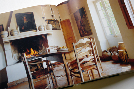 "page showing dining table & chairs in front of an open fire from ""The Way We Live In the Country"" by Stafford Cliff & Gilles de Chabaneix"
