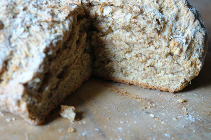 homemade Irish soda bread with slice removed