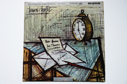 Ella Fitzgerald LP cover of a table with alarm clock, paper, envelope and pen illustrated by Bernard Buffet