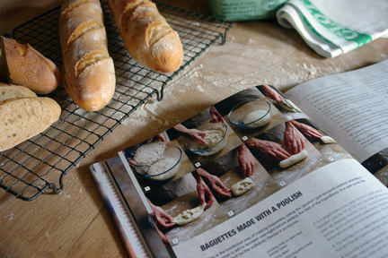 "trio of cooked baguettes with baguette recipe from Emmanuel Hadjiandreou's ""How to Make Bread"" book"