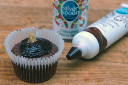 chocolate and ginger cupcake with Silver Spoon chocolate flavoured icing and chocolate beans supplied by Baking Mad