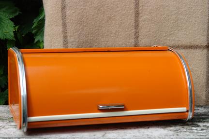 vintage orange painted metal bread bin