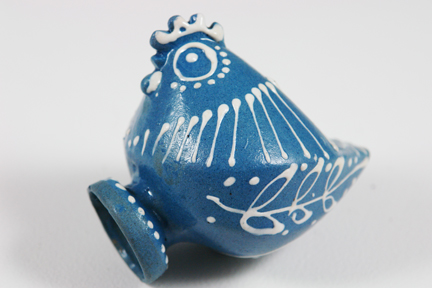 side detail from a small blue slipware pottery figure of a chicken