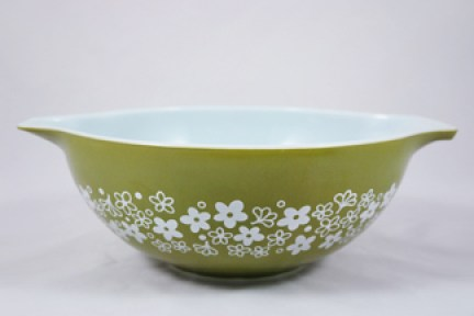 vintage Pyrex bowl decorated with green flower motif