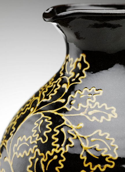 detail from handmade jug slip decorated with oak leaves by potter Hannah McAndrew