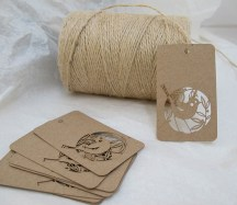 Laser cut Skinny laMinx brown card tags with ball of brown string