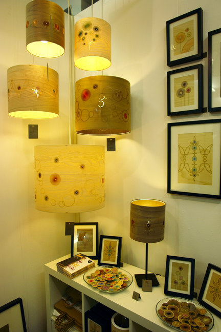 a display of Jane Blease's handcrafted wooden artworks, lampshades and jewellery
